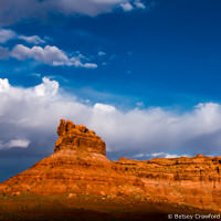 Red rock and clouds in the Valley of the Gods in southeastern Utah by Betsey Crawford