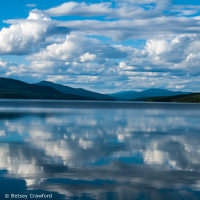 Celebrating Laudato si: clouds reflected in Dease Lake, British Columbia