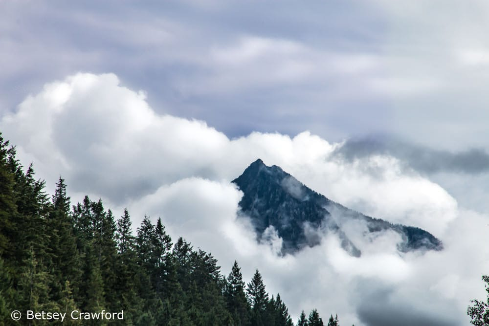 Mountain top in the clouds in Golden, British Columbia by Betsey Crawford