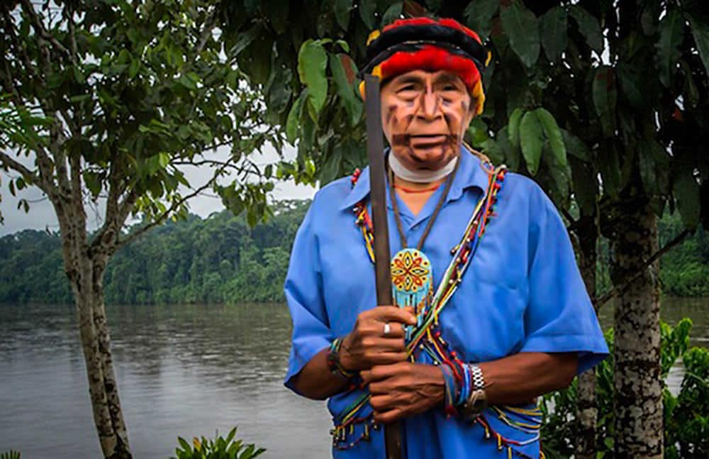 Indigenous man in Amazon rainforest from the Pachamama Alliance